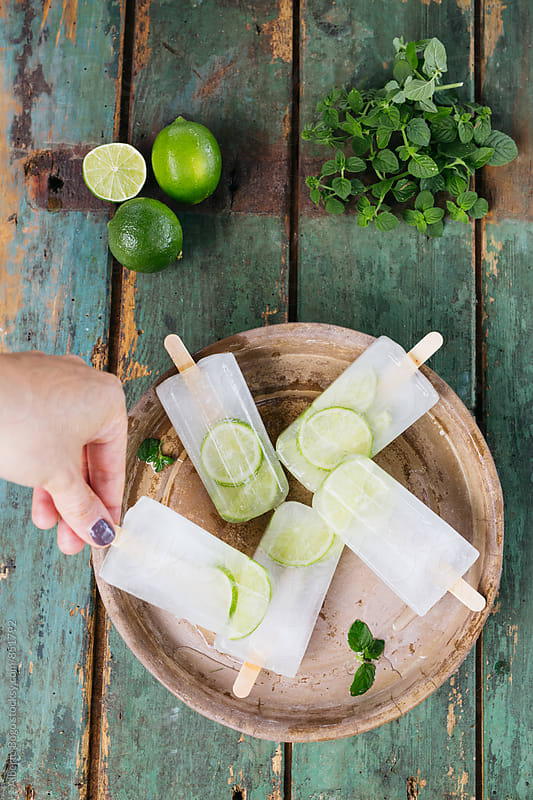 Lime and mint ice pops by Alberto Bogo for Stocksy United