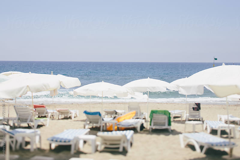 Beach with lounge chairs by Andrey Pavlov for Stocksy United