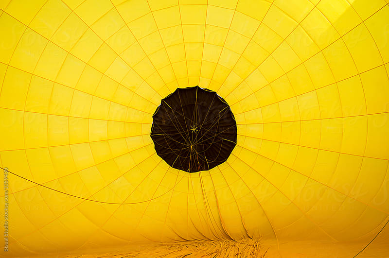 Blowing up hot air balloons, inside a balloon by Bisual Studio for Stocksy United