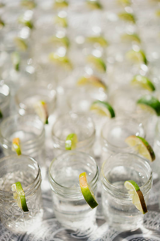 Mason jar glasses of water with lime by otto schulze for Stocksy United