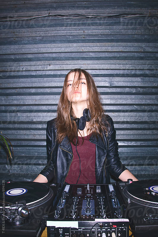 Portrait of attractive young female DJ at DJ desk by T-REX & Flower for Stocksy United