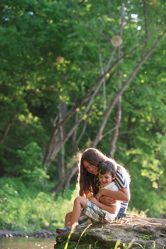 Playing in the creek by Melanie DeFazio for Stocksy United