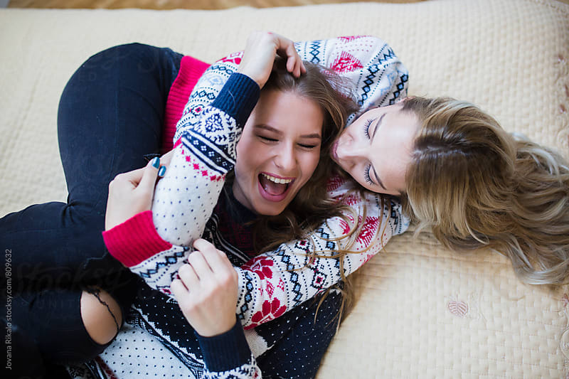 Two happy female friends by Jovana Rikalo for Stocksy United