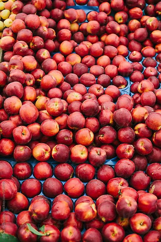 Fresh nectarines in the market by Borislav Zhuykov for Stocksy United
