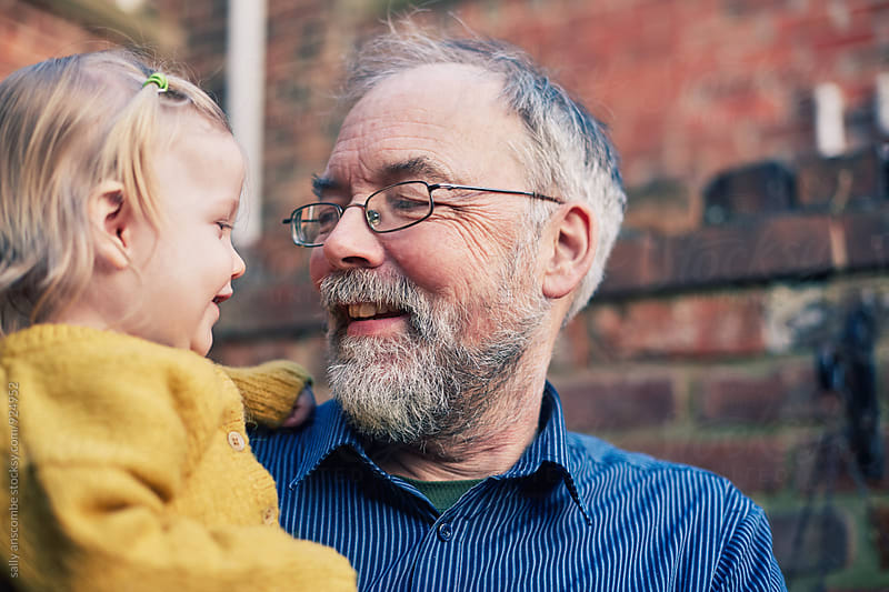 Grandfather and Granddaughter together by sally anscombe for Stocksy United