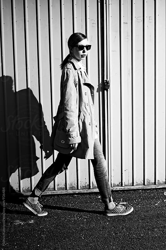 Girl walking on sunny day by Hamza Kulenović for Stocksy United