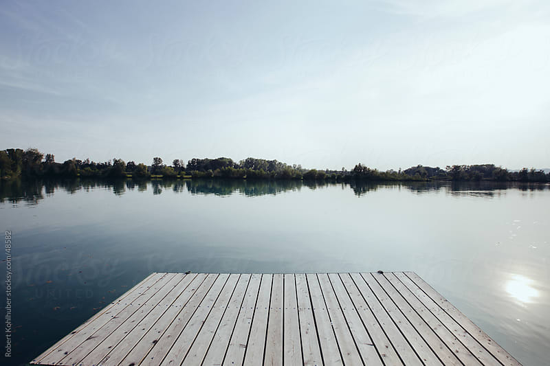 Pier at a Lake in summer by Robert Kohlhuber for Stocksy United