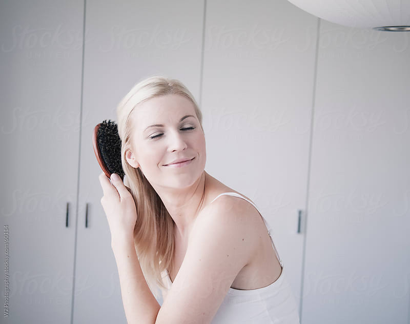 Getting ready in the morning, and brushing hair. by W2 Photography for Stocksy United