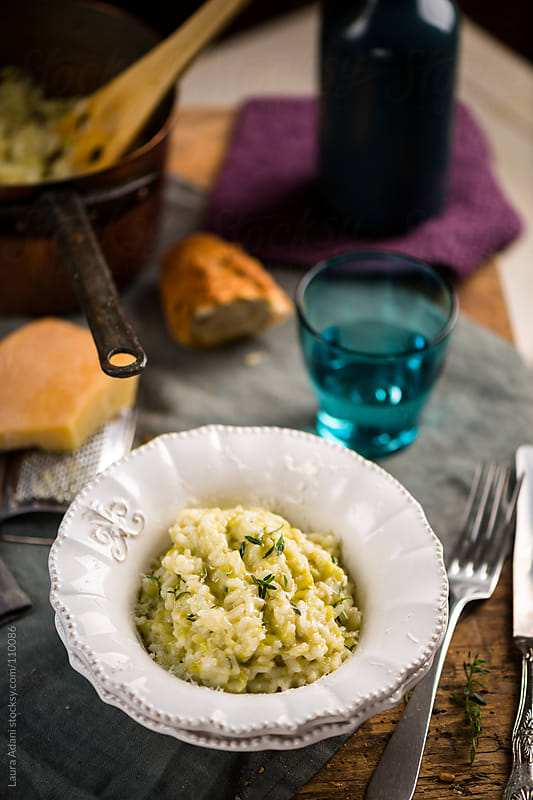 risotto with leeks, pecorino and thyme by Laura Adani for Stocksy United