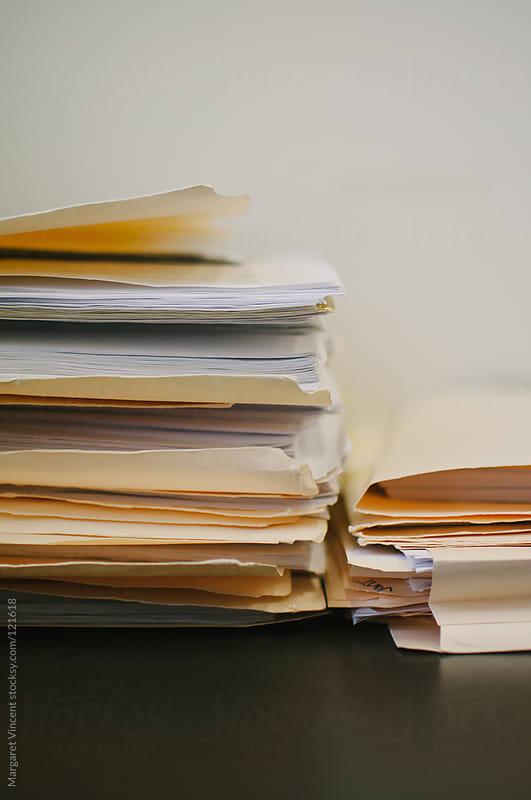 stacks of files in an office by Margaret Vincent for Stocksy United