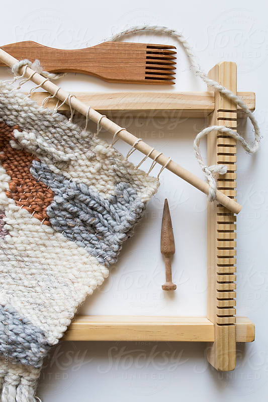 Weaving, loom and wood tools by Carey Shaw for Stocksy United
