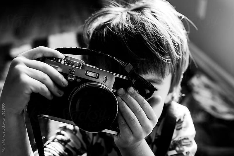 child taking a photo by Maria Manco for Stocksy United