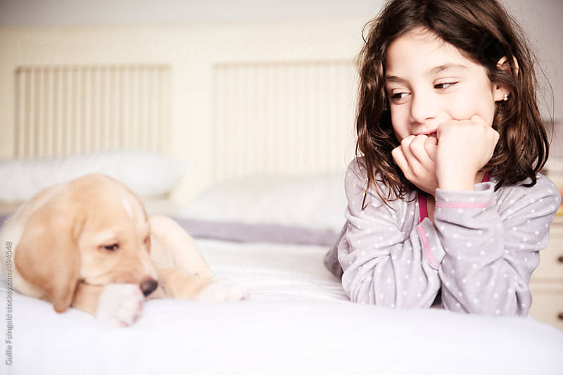 little girl with her puppy by Guille Faingold for Stocksy United