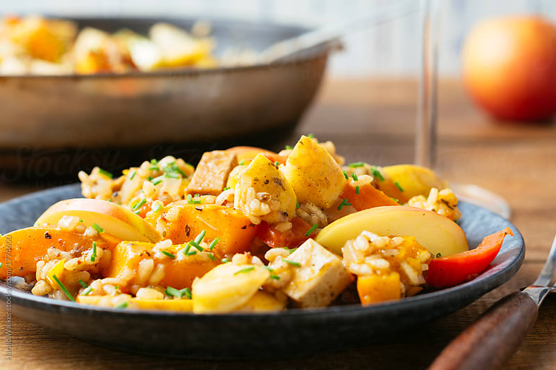 Pumpkin and Apple Risotto with Tofu Pieces by Harald Walker for Stocksy United