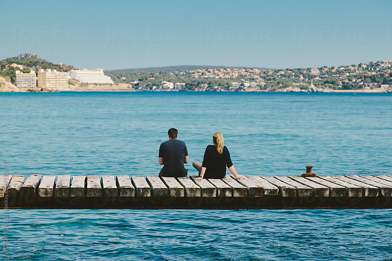 Couple Looking at Mediterranean Sea by VICTOR TORRES for Stocksy United