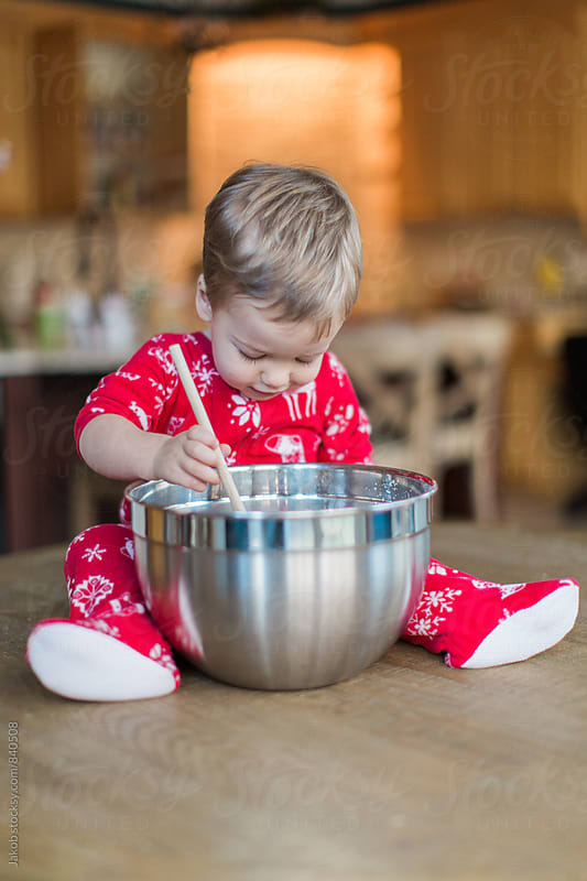 Cute young boy stirring a large bowl by Jakob for Stocksy United