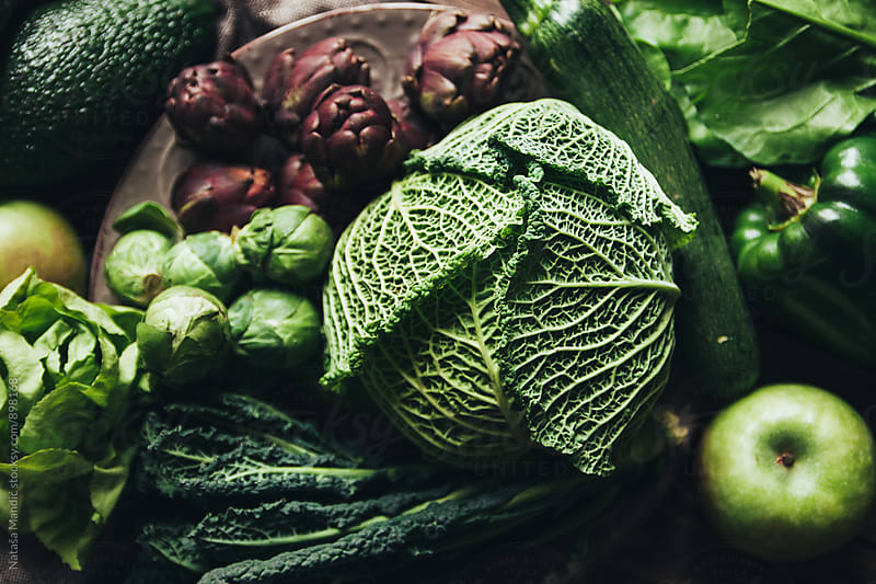 Green vegetables on table by Nataša Mandić for Stocksy United