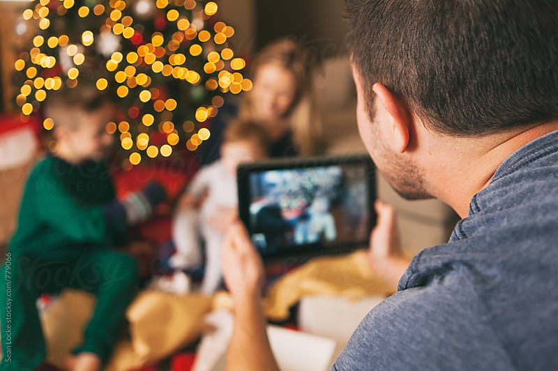 Christmas: Father Taking Photo On Digital Tablet by Sean Locke for Stocksy United
