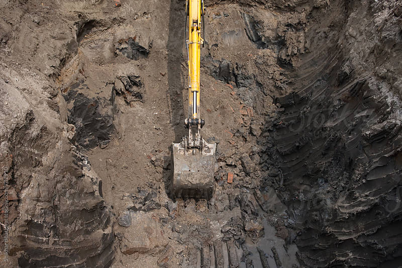 Top view of an excavator digging in the ground. by Shikhar Bhattarai for Stocksy United