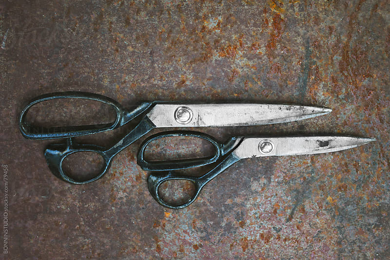 Pair of vintage scissors on metal background. by BONNINSTUDIO for Stocksy United