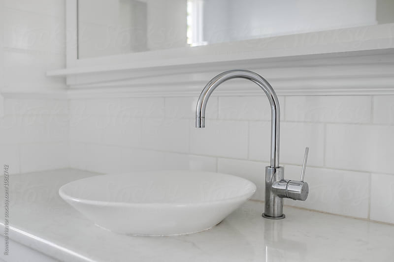 White modern hand basin by Rowena Naylor for Stocksy United
