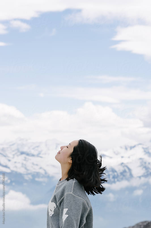 Side profile of a woman looking away, Swiss Alps, Switzerland by MaaHoo Studio for Stocksy United