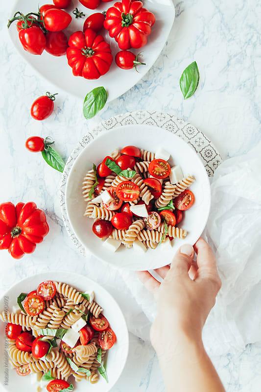 Delicious pasta caprese by Nataša Mandić for Stocksy United
