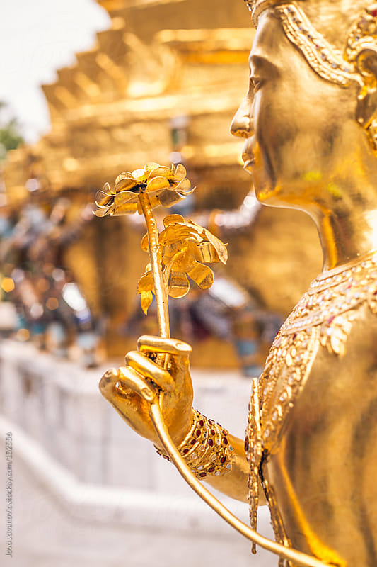 Golden Asian statue in Wat Pho. by Jovo Jovanovic for Stocksy United