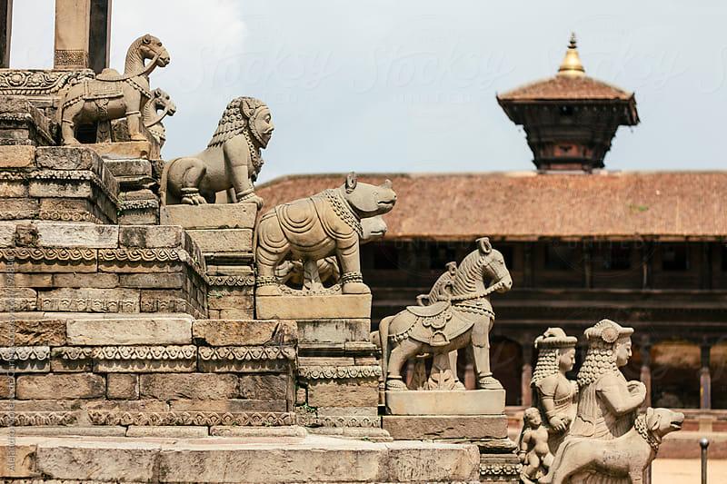 Hindu temple statues of animals on a stair, Kathmandu, Nepal by Alejandro Moreno de Carlos for Stocksy United