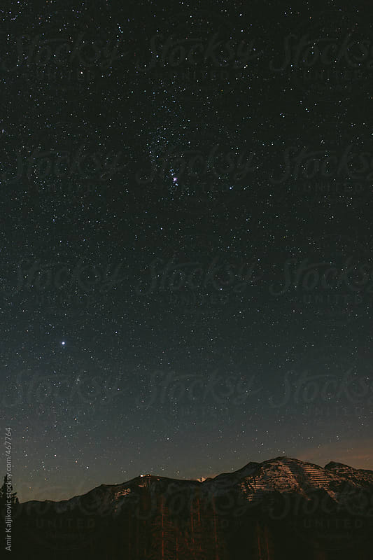 Starry night sky with twinkling stars by Amir Kaljikovic for Stocksy United