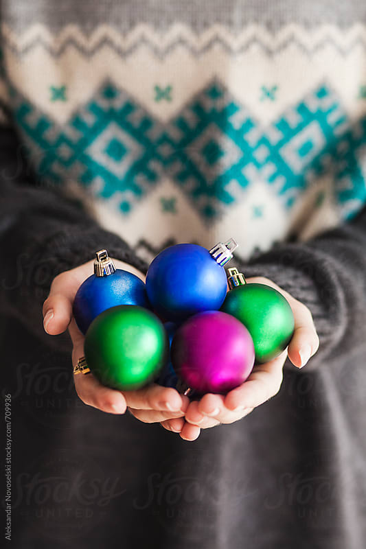 Woman holding colorful christmas balls by Aleksandar Novoselski for Stocksy United