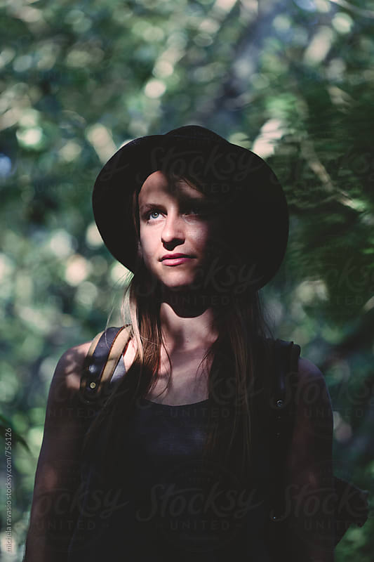 Portrait of young beautiful woman in the forest by michela ravasio for Stocksy United