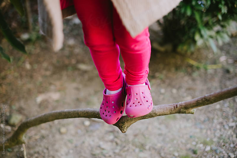 Kid standing on tree branch by Lauren Naefe for Stocksy United