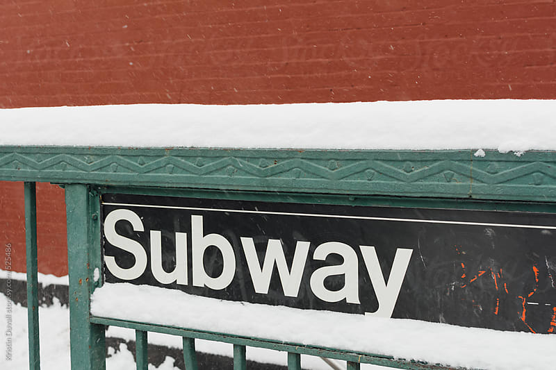 Subway station sign during snowstorm. New York City. by Kristin Duvall for Stocksy United