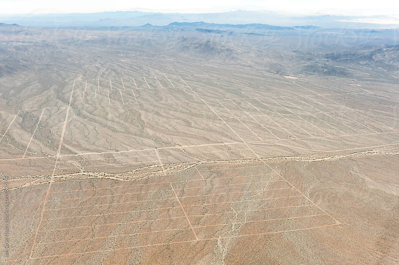 Aerial view of abandoned Nevada subdivision by Jen Grantham for Stocksy United