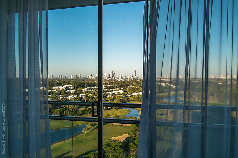 The Skyline of Surfers Paradise from one of the many highrise resort guestrooms by Rowena Naylor for Stocksy United