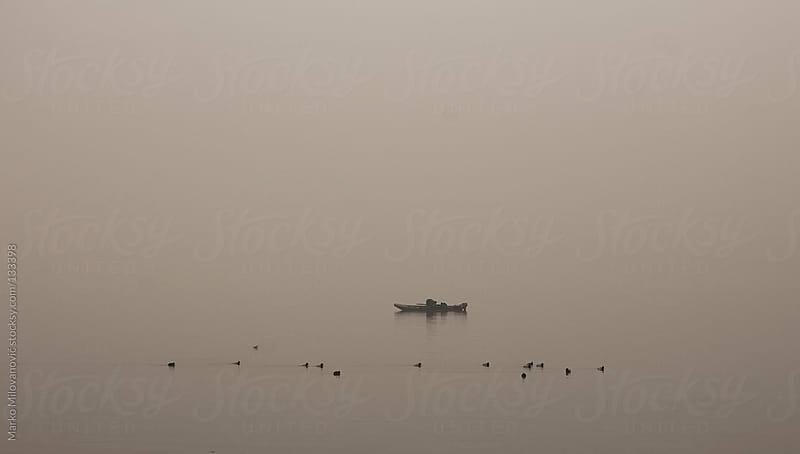 Friends fishing at the lake by Marko Milovanović for Stocksy United