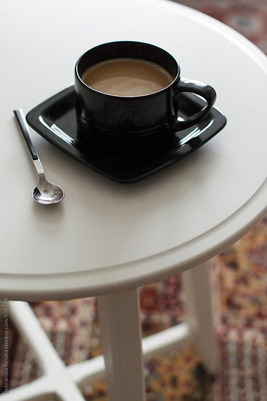 Cup of coffee on table by Dobránska Renáta for Stocksy United