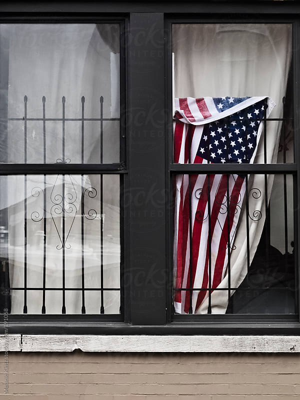 Window with American Flag by Melanie Kintz for Stocksy United