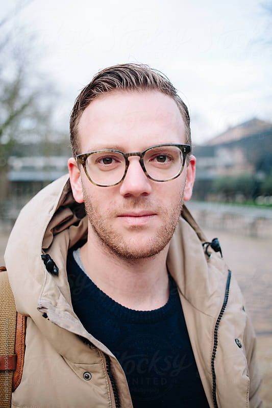 Portrait of a young man with glasses on a cold autumn day by Ivo de Bruijn for Stocksy United