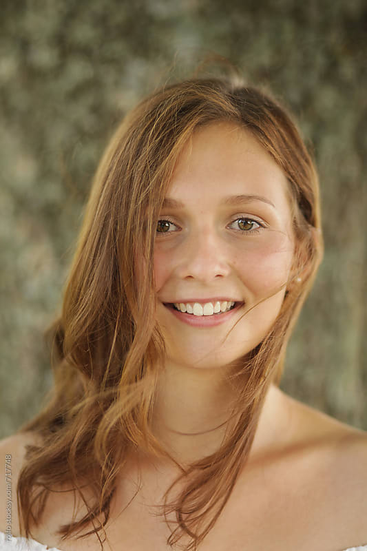 Beautiful young happy woman portrait by rolfo for Stocksy United