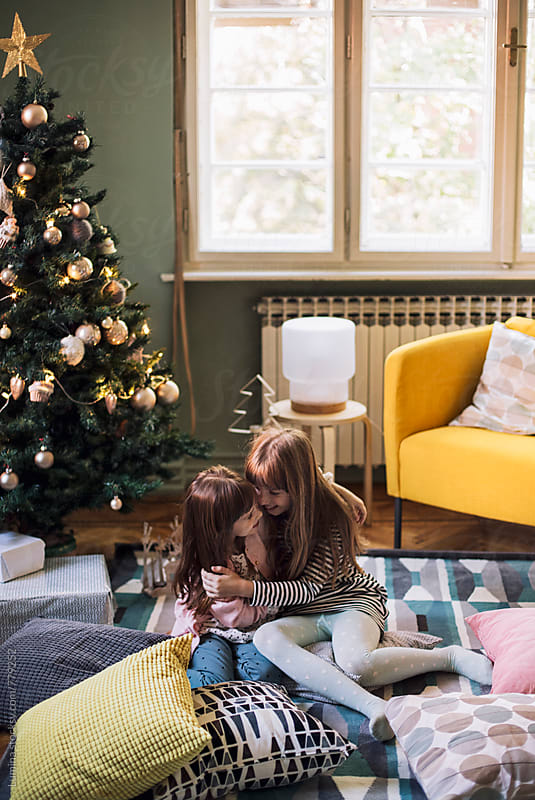 Sisters Playing Together at Christmas  by Lumina for Stocksy United