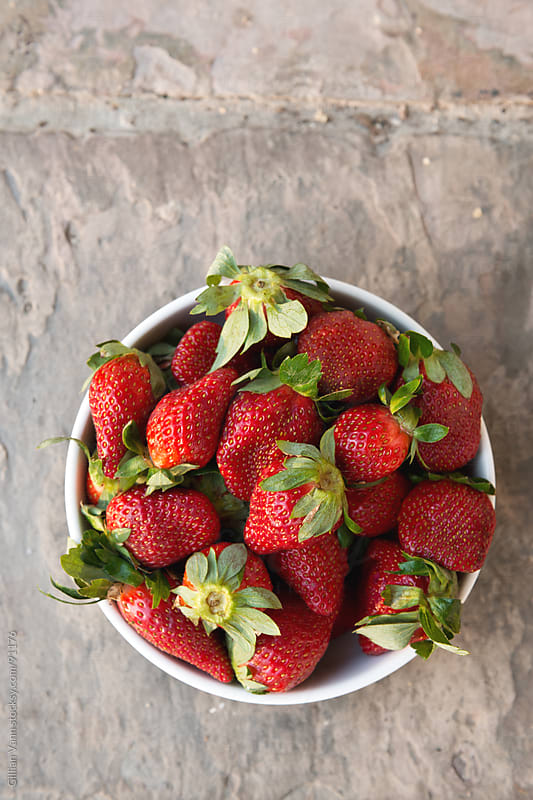 strawberries on a slate tile by Gillian Vann for Stocksy United
