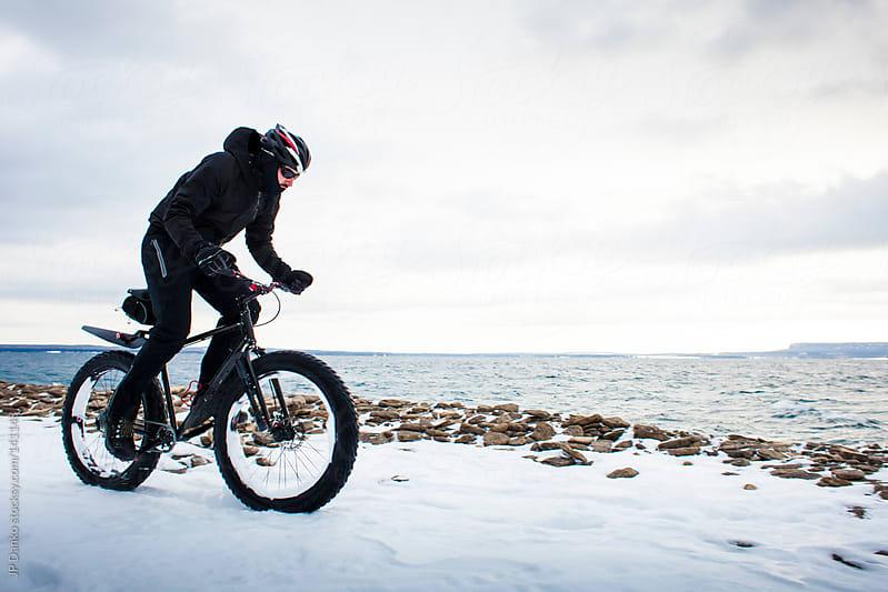 Extreme Sport Winter Mountain Biking  Man Riding Fat Bike In Snow by JP Danko for Stocksy United
