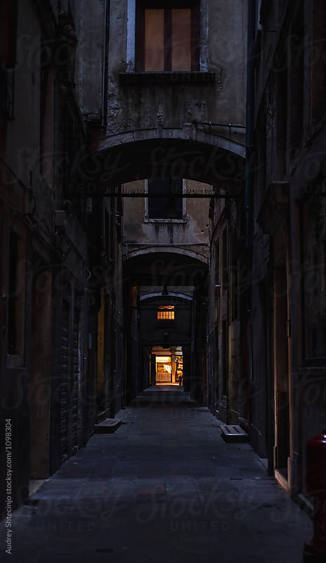 Spooky back alley during evening hours.Italy by Marko Milanovic for Stocksy United