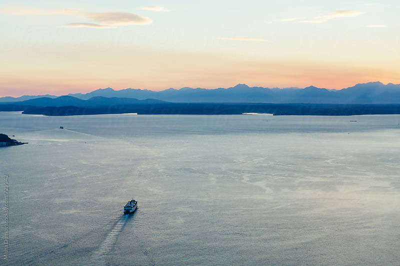 Aerial view of Washington State ferry and Puget Sound at sunset by Mihael Blikshteyn for Stocksy United