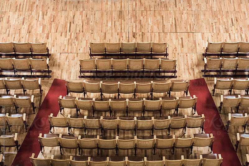 Seats in stylish theater with red carpet by Per Swantesson for Stocksy United