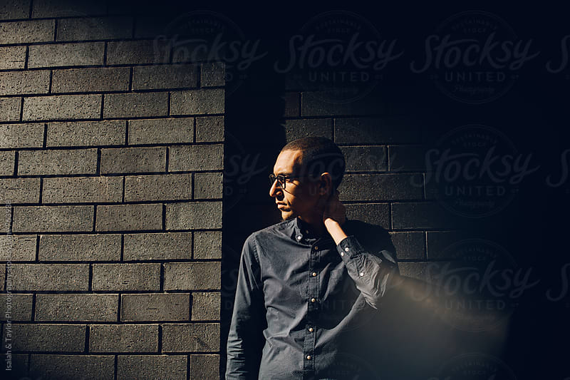 Young man waiting by Isaiah & Taylor Photography for Stocksy United