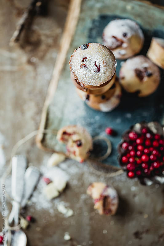 Homemade muffins with wild cranberries and white chocolate by Tatjana Zlatkovic for Stocksy United