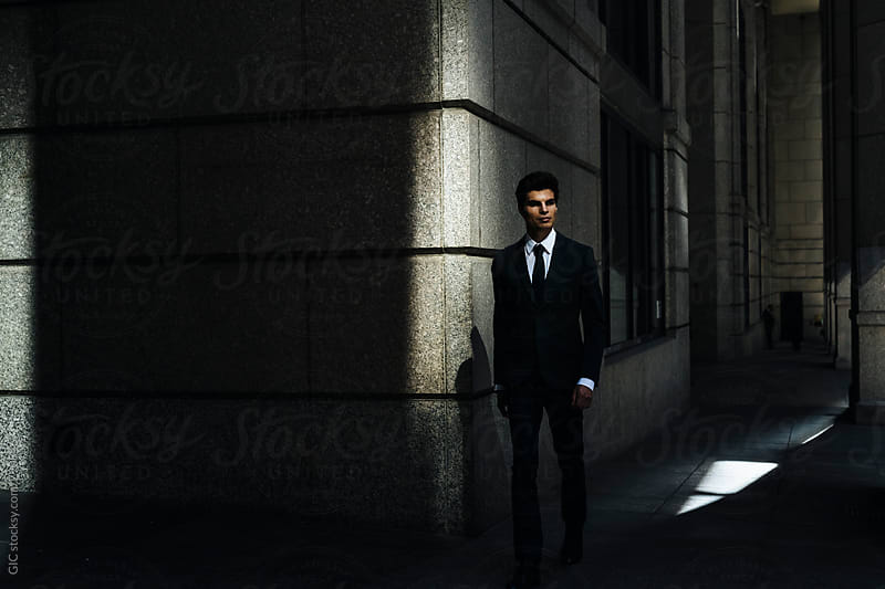 Businessman in the shade by Simone Becchetti for Stocksy United